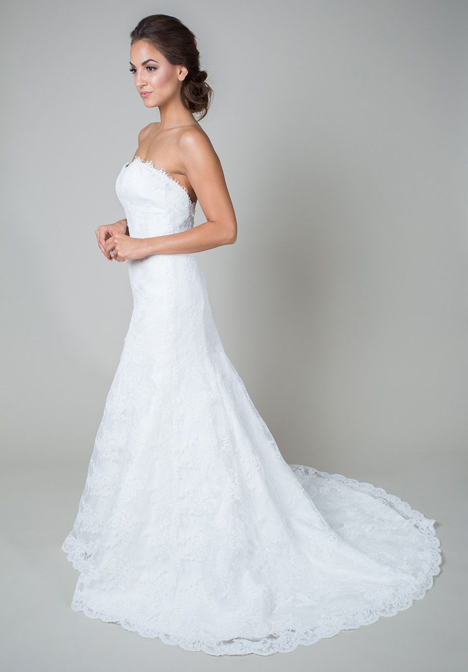 Riley Grace | Heidi Elnora Classic and traditional, this fit-to-flare gown features a sweetheart neckline, corded swiss dot lace, a low back, and a chapel train. http://heidielnora.com/dress/riley-grace/