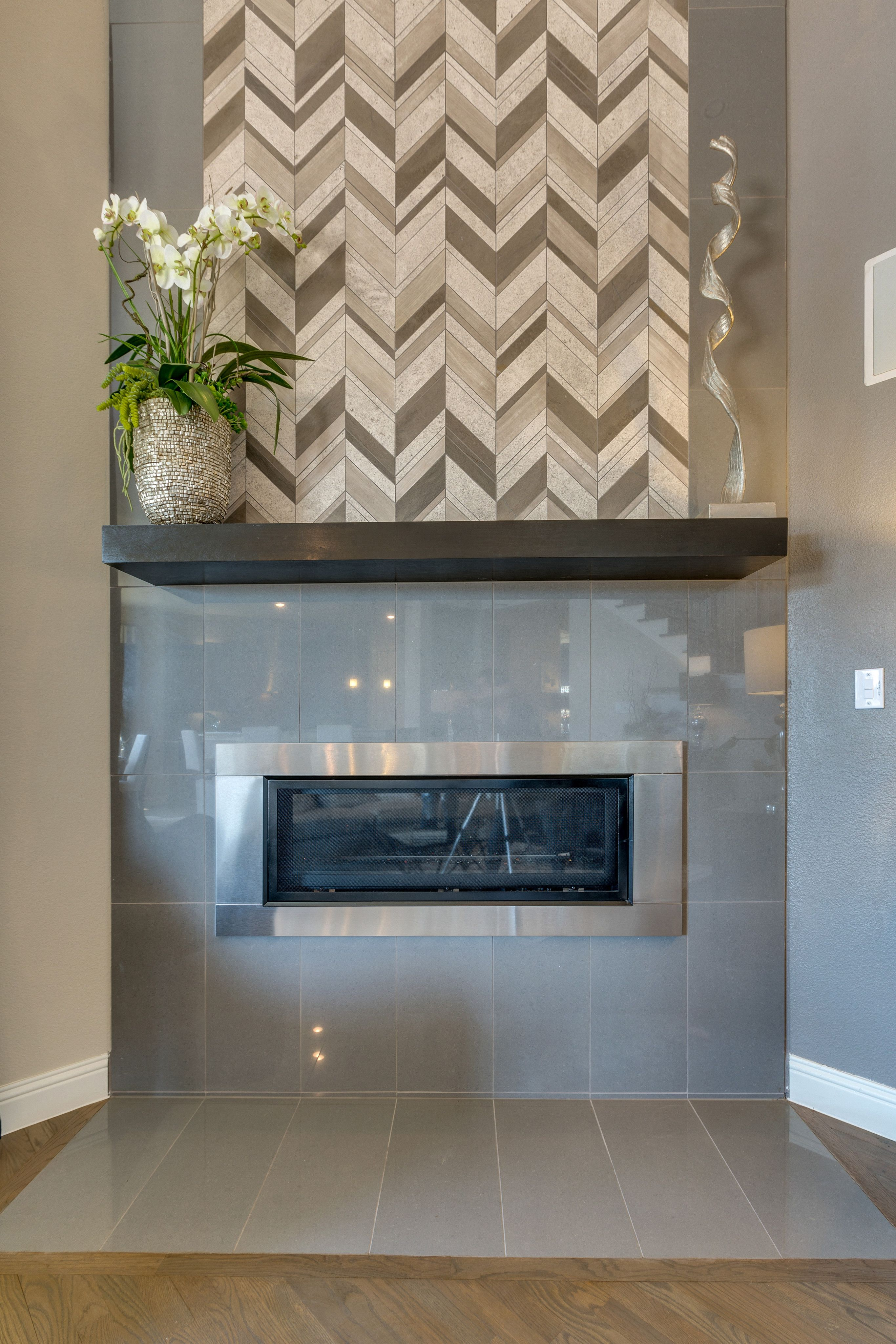 Gehan Homes Brown Fireplace Grey Vertical Tile Fireplace With A