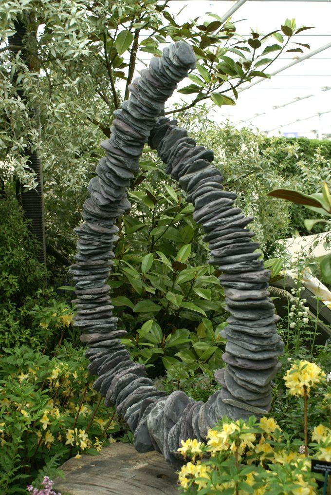 Stone Circle In Garden. Grubby Little Faces