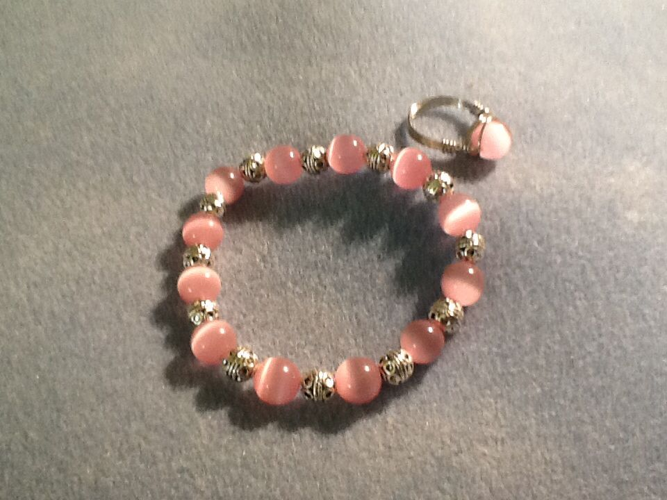 Pink cat eye bracelet with ring $15 Ladybequi@gmail.com