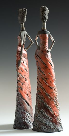 Tony Foard Ceramics / English potter specialising in raku and smoke fired figurative ceramics. He makes tall slender female figures with a predominately African feel and what his hope is 'attitude', together with wall pieces and pots of various shapes and sizes.