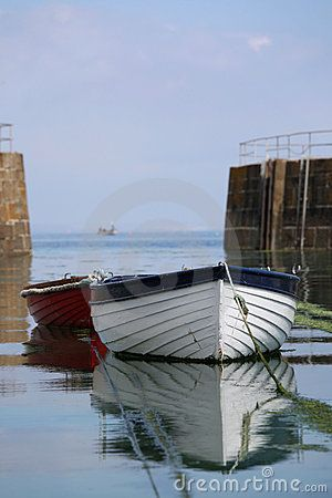 Rowing boats moored at Mousehole harbour in Cornwall (UK)