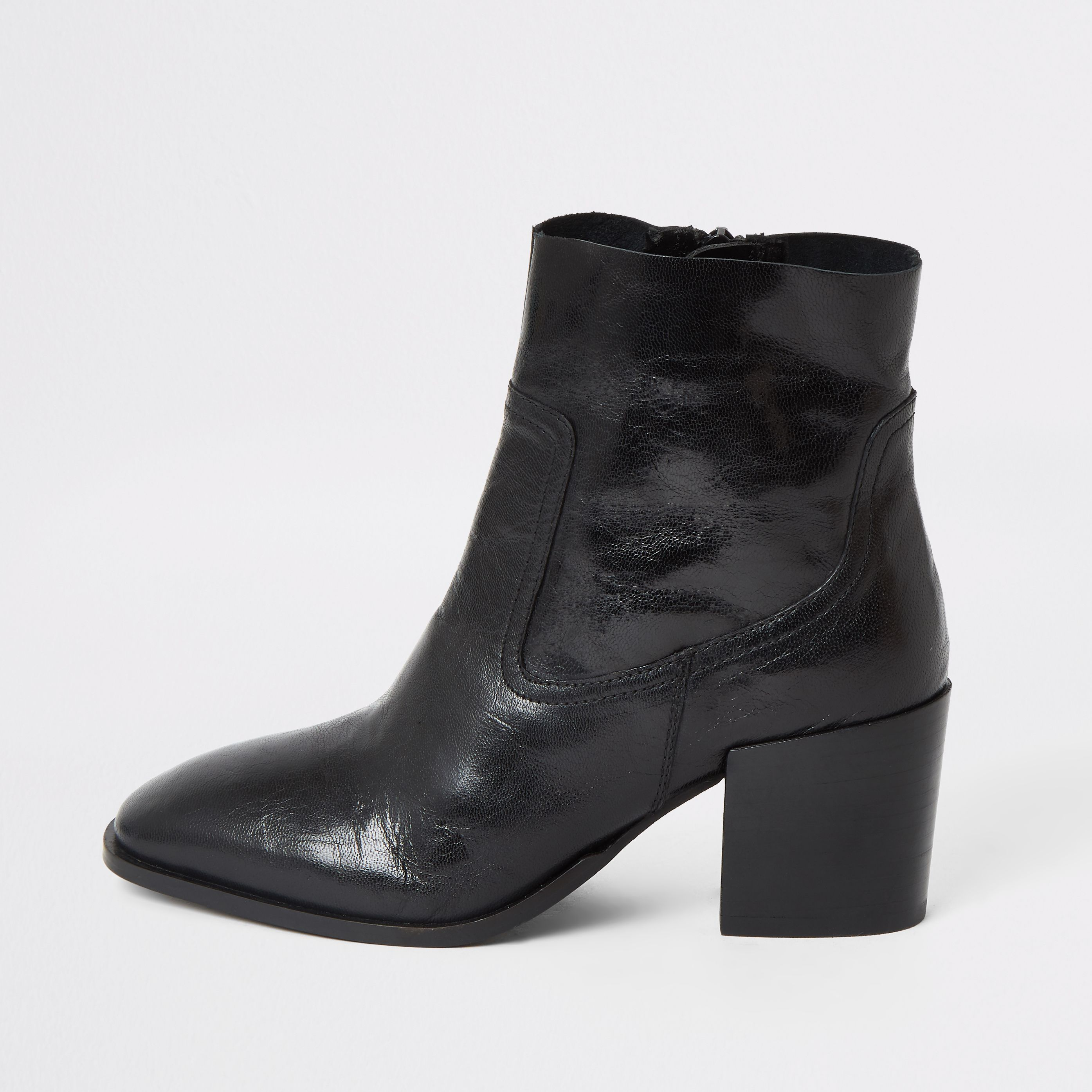 Black leather heeled ankle boots in
