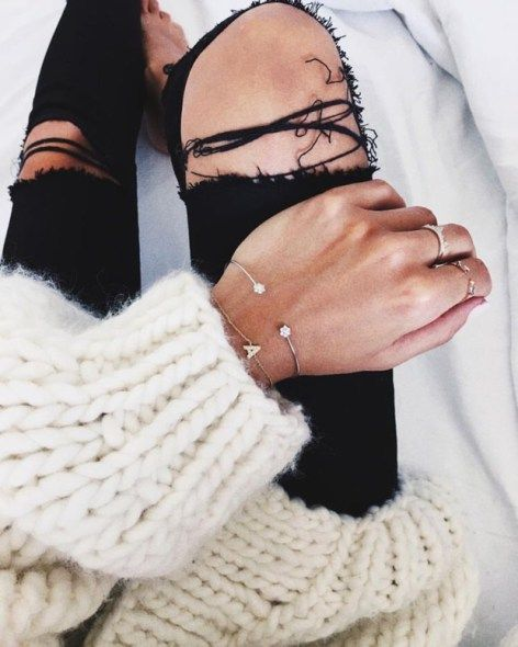 a37f2ea596 Winter jewelry layering with a chunky white knit sweater and ripped black  skinny jeans