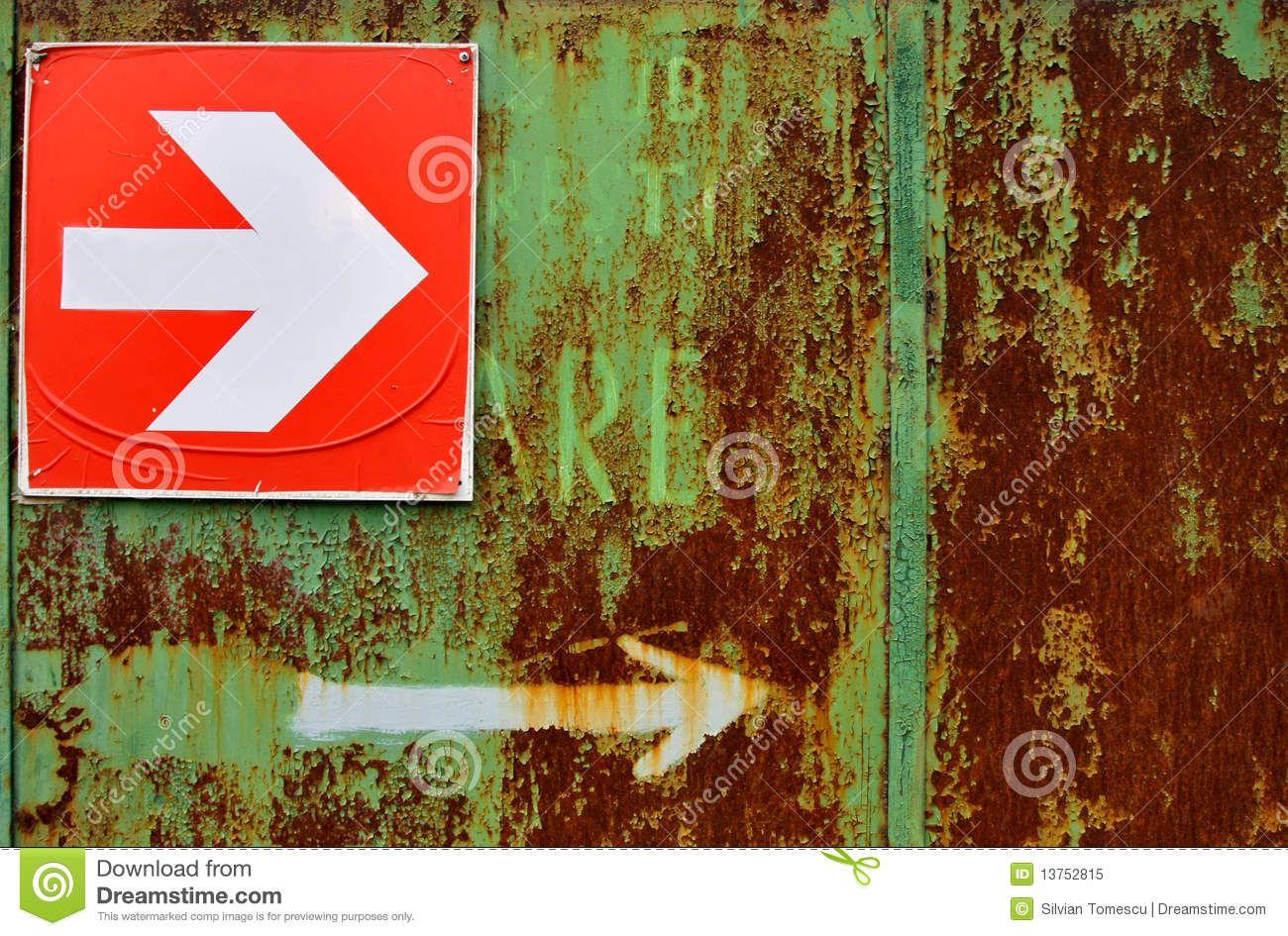 http://thumbs.dreamstime.com/z/rusty-arrow-sign-13752815.jpg