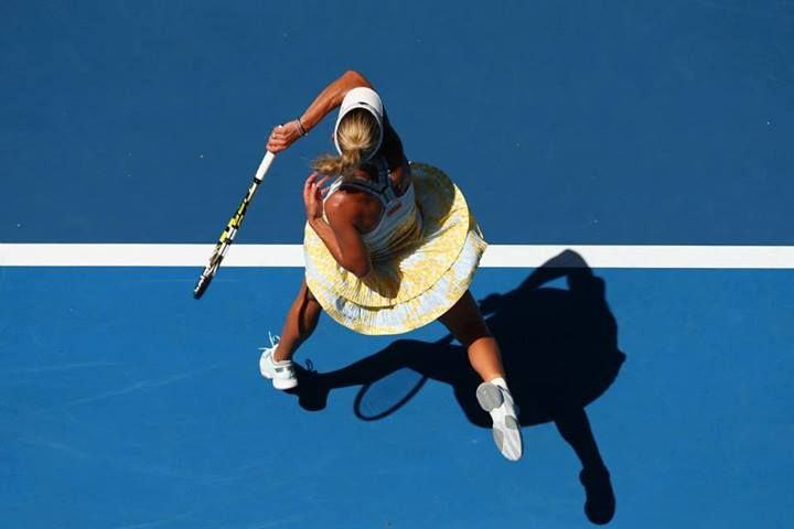 Caroline Wozniacki of Denmark plays a forehand in her first round match against Lourdes Dominguez Lino of Spain during day two of the 2014 Australian Open at Melbourne Park on January 14, 2014 in Melbourne, Australia. #WTA #Wozniacki #AUSOpen