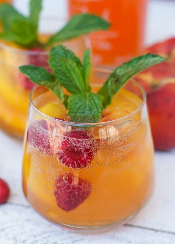 This Peach Raspberry Spritzer is the perfect summery drink ...