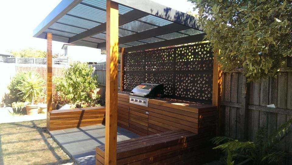 Outdoor bbq in timber housing with steel screen outdoor for Outside barbecue area design