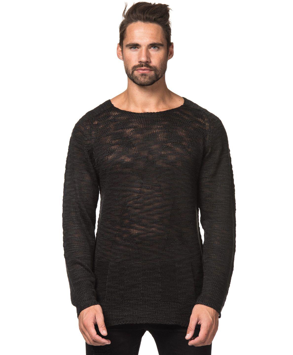 Fred Flag Knit Stickad tröja från Adrian Hammond. Denna tröja är svart och  glest stickad a59e9d61c1f30