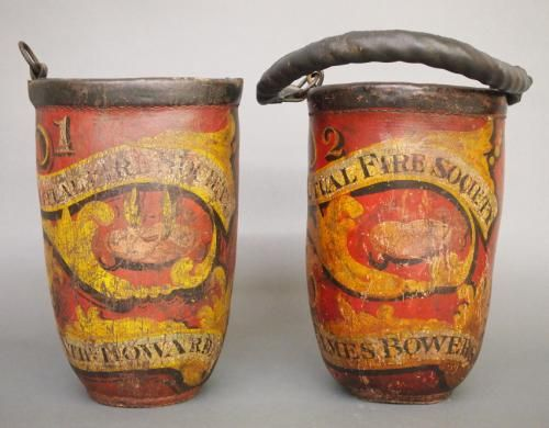 """Two 19th century American leather Fire buckets with the original polychrome painted decoration. From the """"Mutual Fire Society"""", bucket #1 """"N"""
