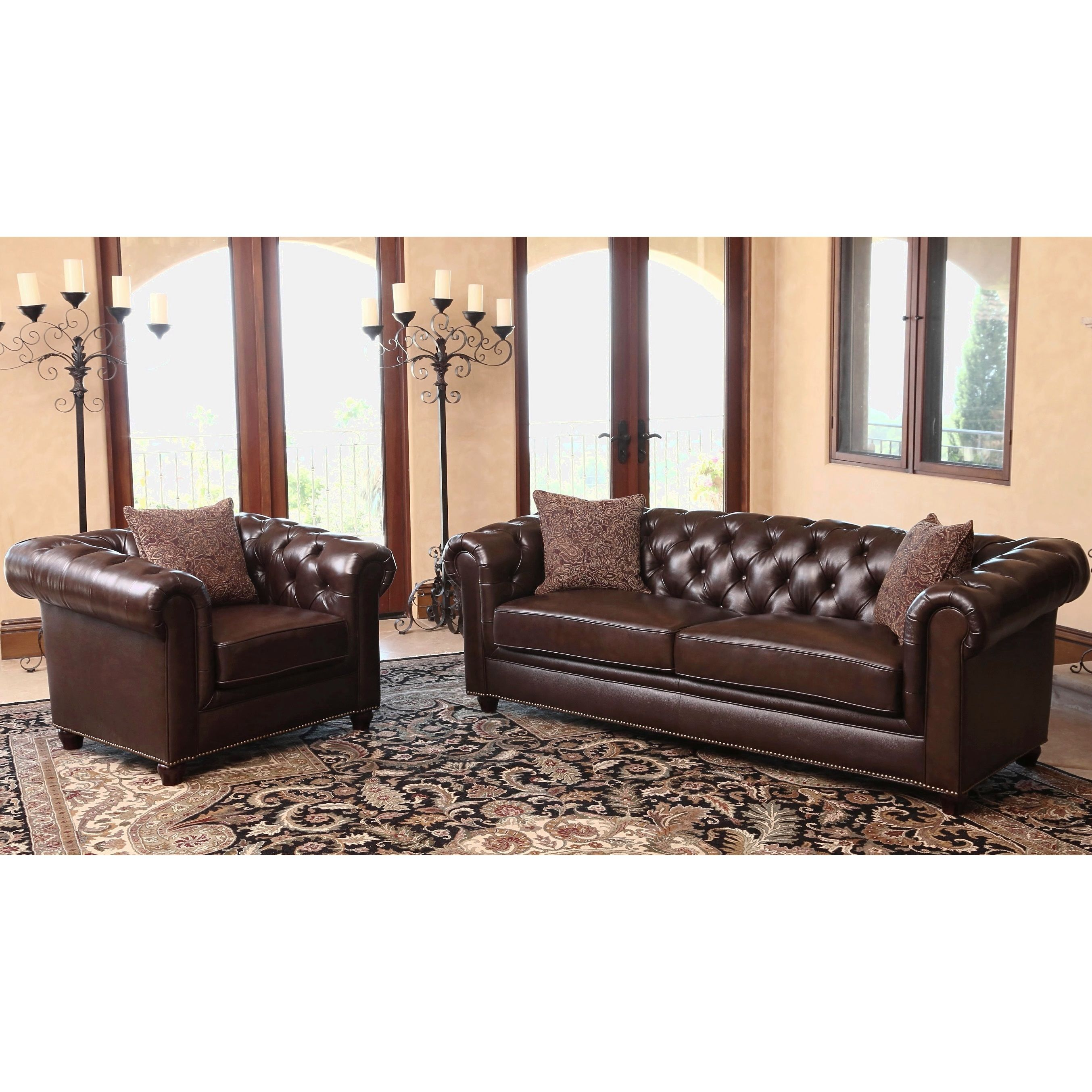 crafted of durable high grade italian leather that is both soft and supple this sofa and armchair set provides both comfort and class with its