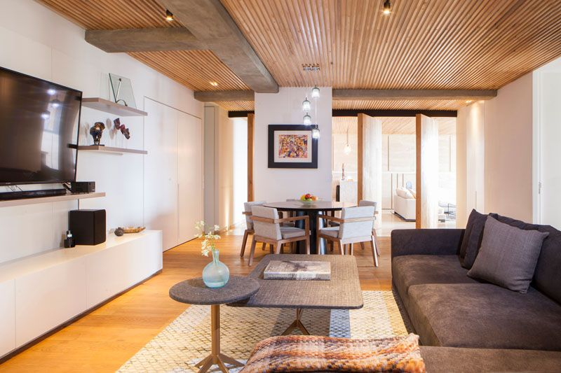 An Elegant Apartment With A Wood Slat Ceiling Living Room Designs Casual Dining Rooms Wood Slat Ceiling