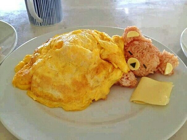 Sticky rice bear with omelette blanket. Don't lie... you think it's cute too.   By Fancy Edibles.
