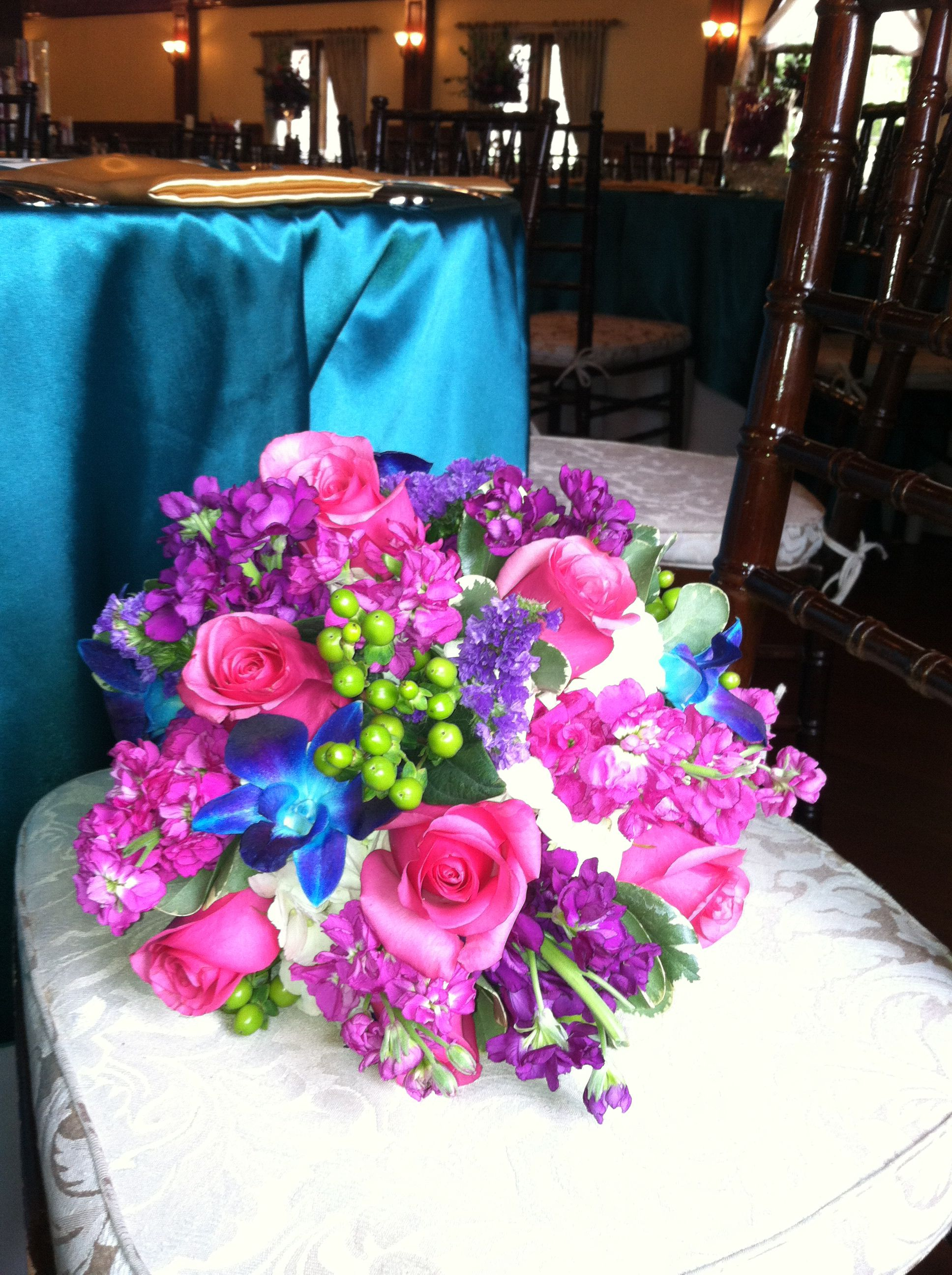 Peacock wedding . The bold color in this bouquet is stunning.
