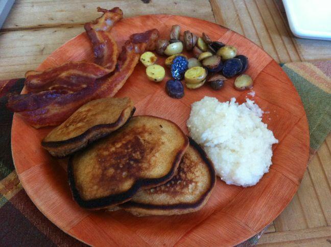 Pumpkin pancakes, baby potatoes, bacon, and grits. YUM