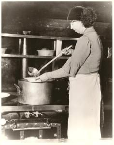 Eleanor Roosevelt spooning out nourishment in a Great Depression soup kitchen ~