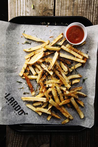 French fries seasoned with rosemary, sage, and parmesan