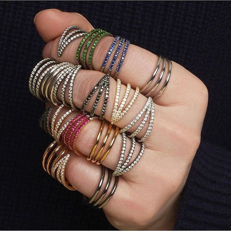 A fistful of Melissa Kaye two-finger reversible rings