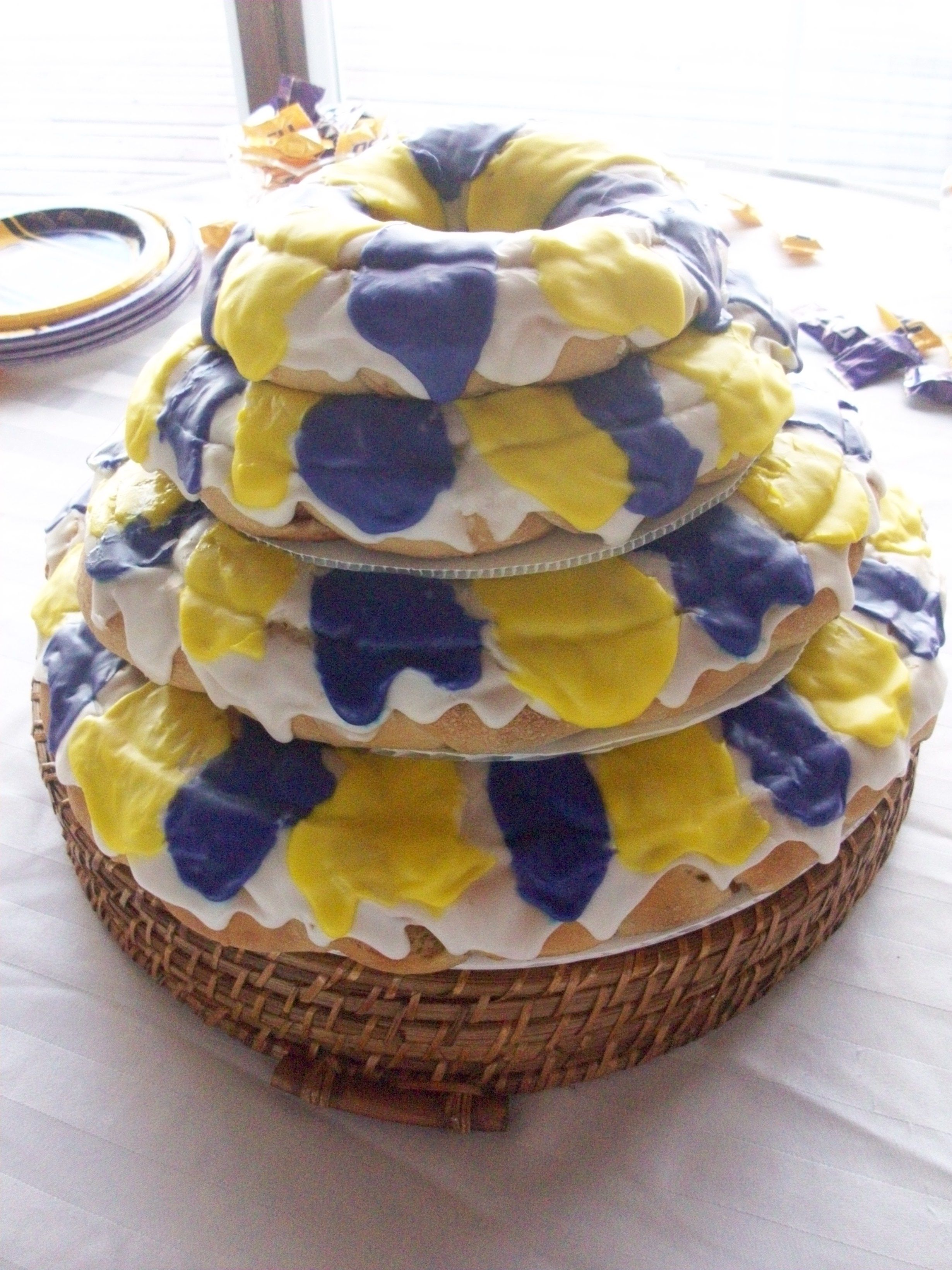 Grooms tiered king cakes in lsu colors king cake