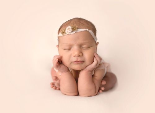 Newborn baby girl froggy pose
