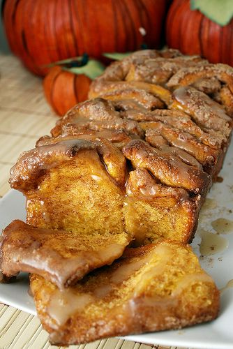 This pumpkin cinnamon pull-apart bread with vanilla glaze is a clever way to get a cinnamon-roll-like taste and texture in bread form that pulls apart.