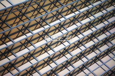low angle shot of commercial building with steel frames. - Low angle view of steel frames on a corporate building.