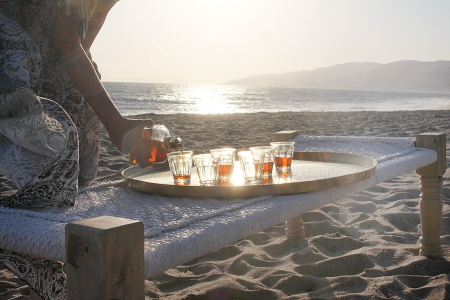 Sunset rhum pour at a St. Barth beach barbecue   Gather