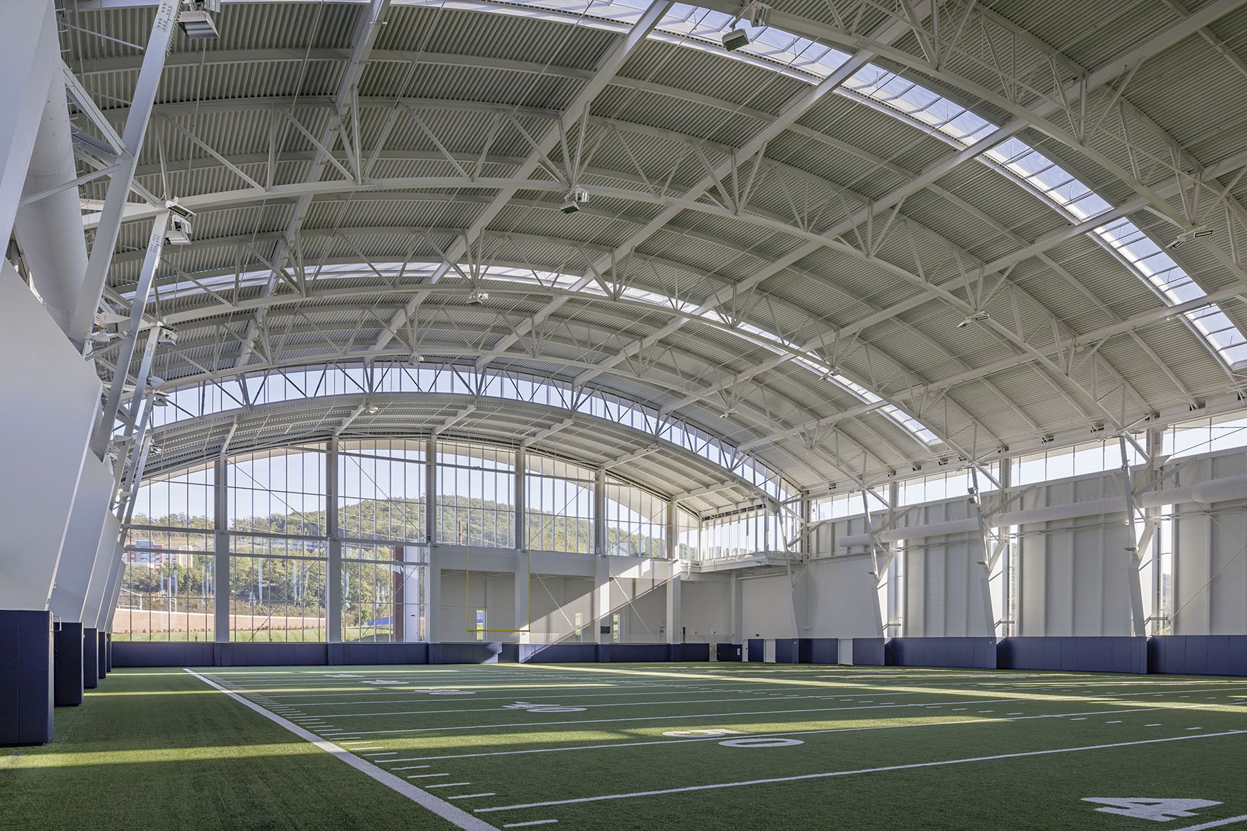 The Fieldhouse Allows Adequate Indoor Facilities For Football And Other Field Sports To Practice At All Ti Indoor Soccer Field Indoor Sports Court Indoor Arena