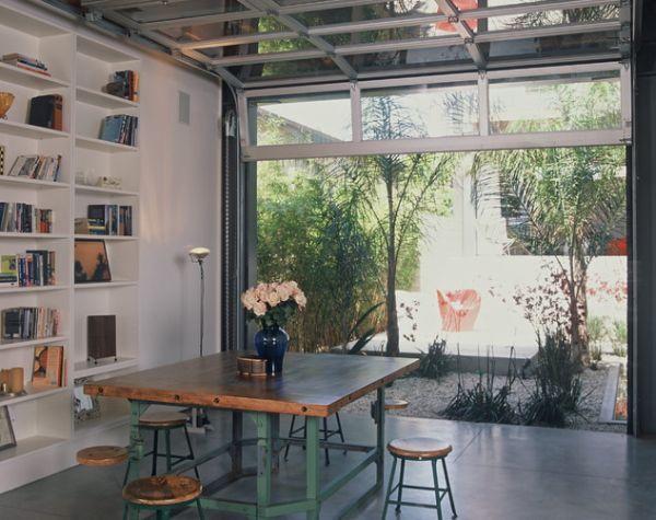 Sectional Glass Garage Doors Used In Modern Designs Glass Garage Glass Garage Door Modern Garage Doors Garage Door Makeover