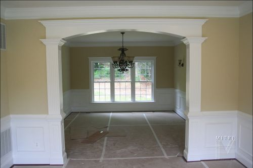 Doorway molding and crown molding with what i believe is for Crown molding ideas dining room