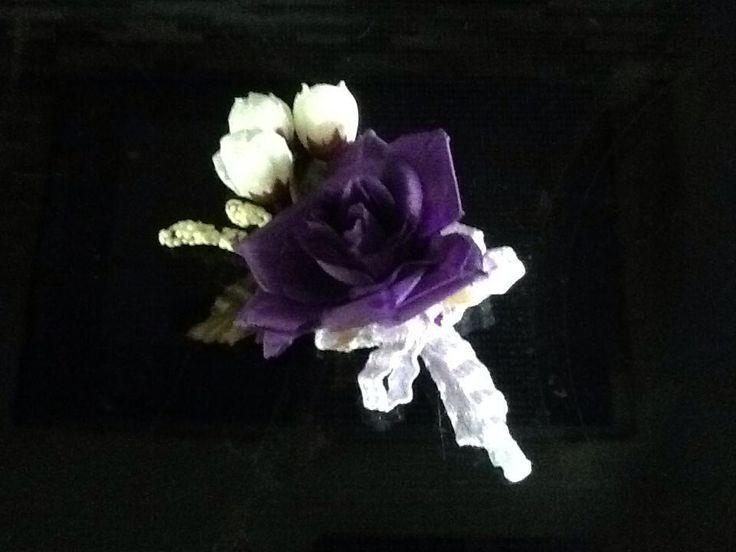 Dark purple rose boutonniere