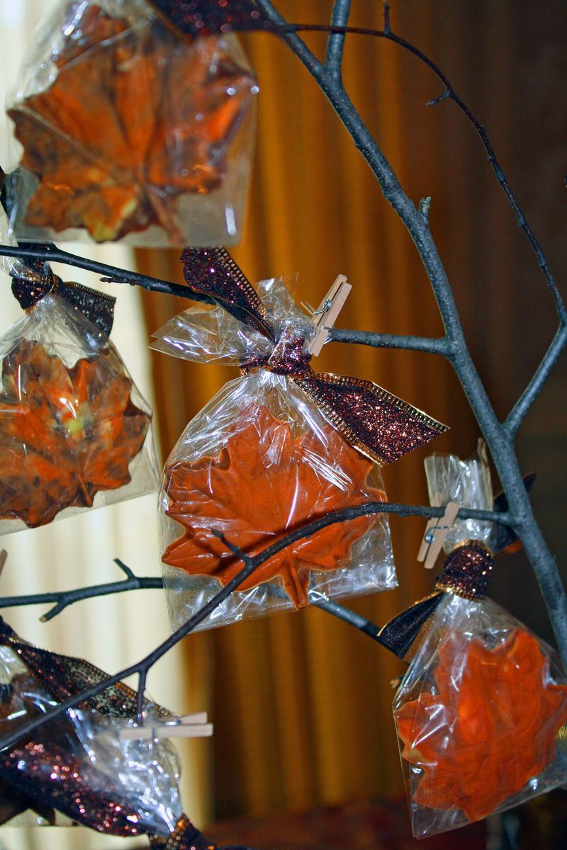 Creating chocolate maple leave favors are very easy and the perfect take-away favor for the Thanksgiving holiday season.