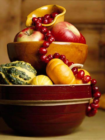 Autumn centerpiece...stack wooden bowls, overflow with mini gourds, apples, and cranberries on a string...lovely