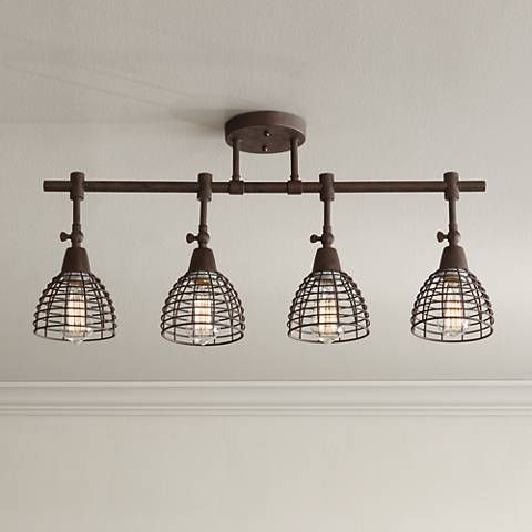 An industrial inspired 4 light track fixture with open wire heads in a deep