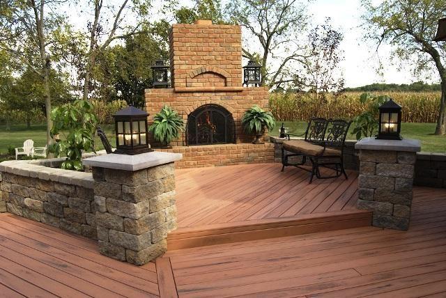 Composite Deck With Fireplace And Seating Walls Deck Designs Backyard Patio Deck Designs Decks Backyard