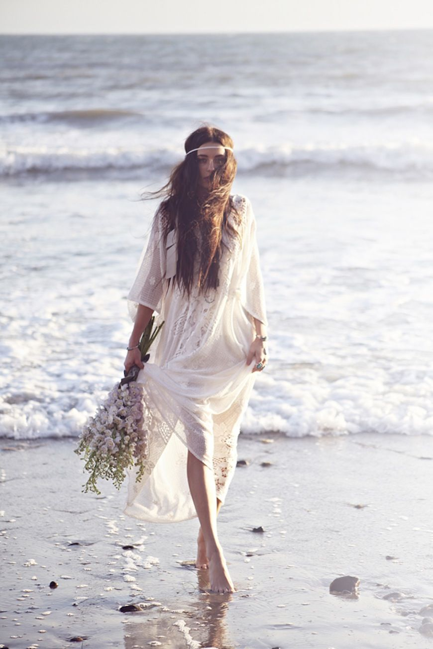 style | beach bride Another photo that captures what I vision a bohemian wedding on the beach should be.  walking barefoot, not scared to get wet, natural hair. Effortless!