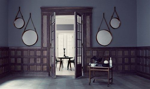 Jacques Adnet Mirror - with leather strap hanging support.