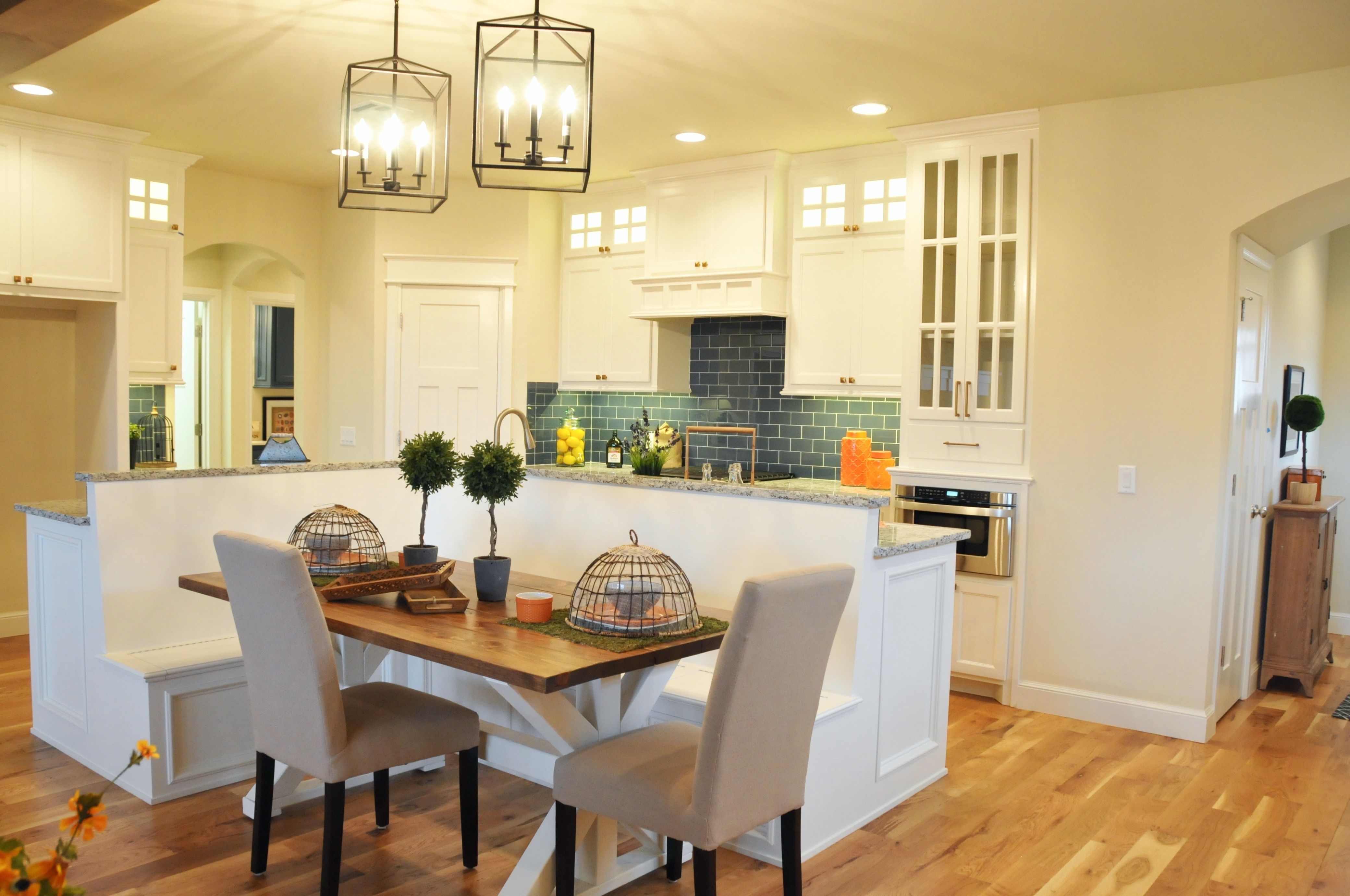 L shaped built in banquette kitchen island mccaleb homes our