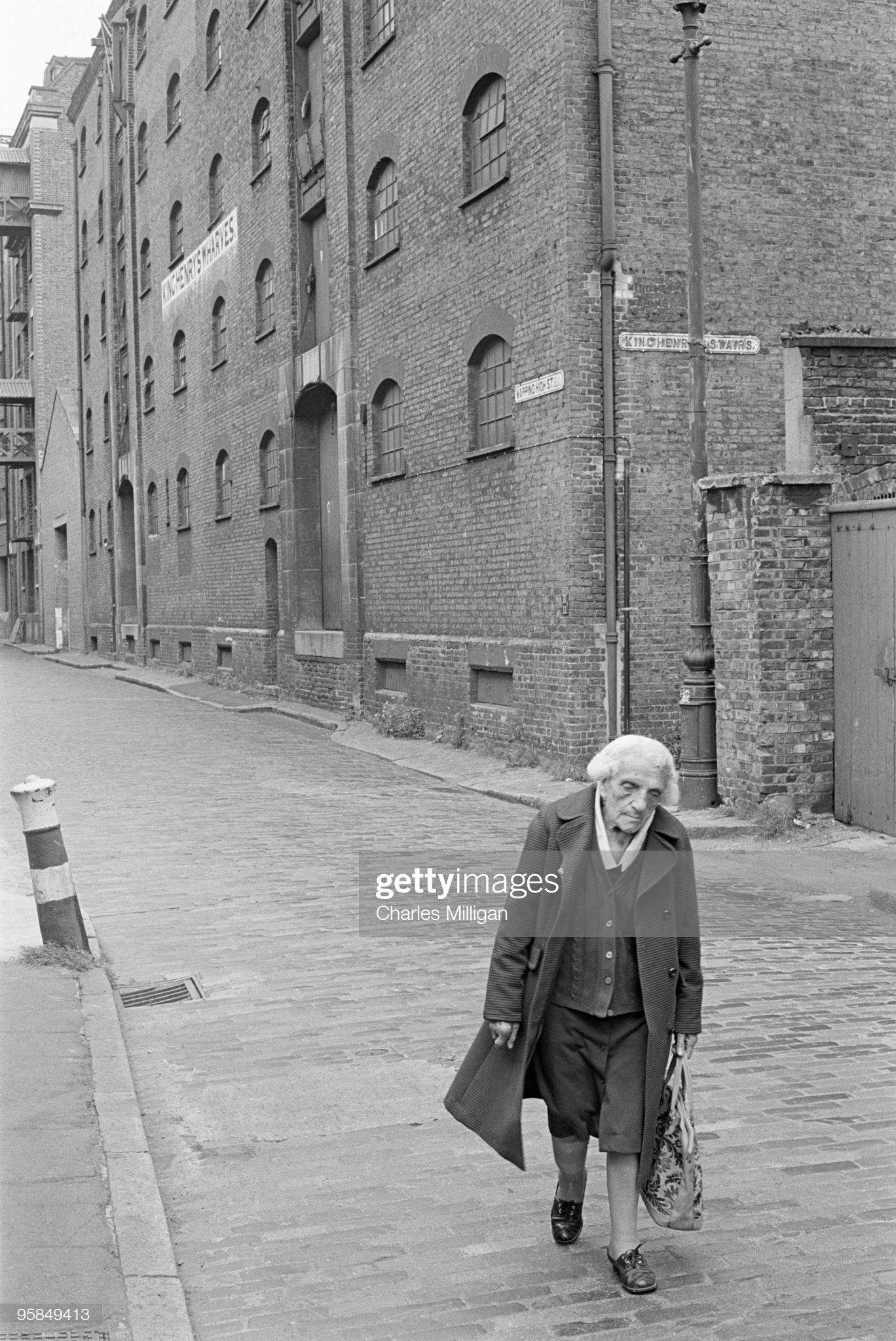 News Photo A elderly woman walking down Wapping High
