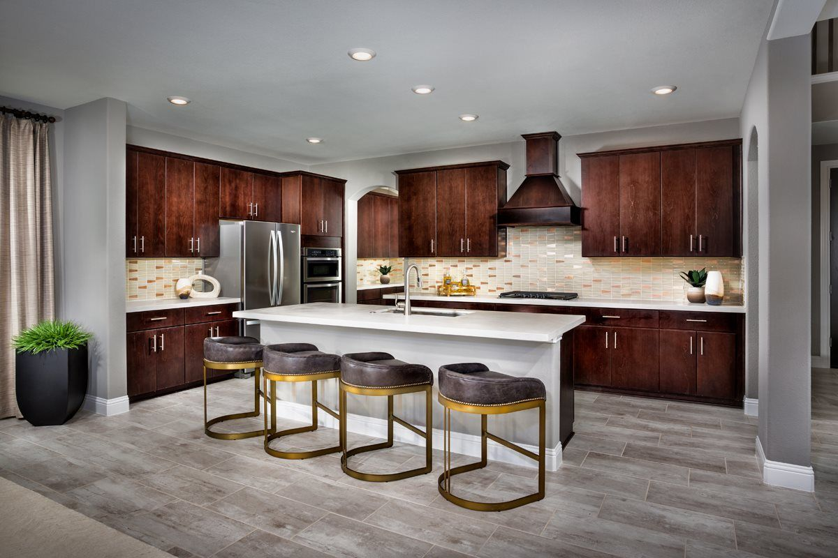 How To Brighten Up A Dark Wood Kitchen Add Gold Accents To Brighten Up Dark Cabinetry And Add A Hint Of Glam To Your Kitchen For A Design That Is Modern Kitchen Design New Home Communities Kb Homes