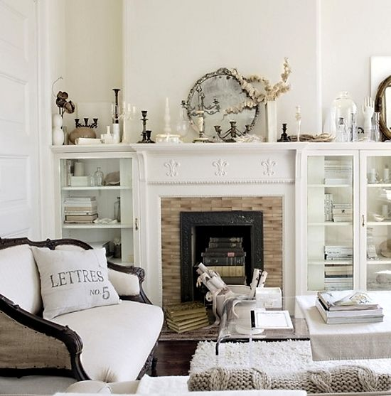 Restoration In White via dustjacket attic #home #white #luxe #fireplaces #flora