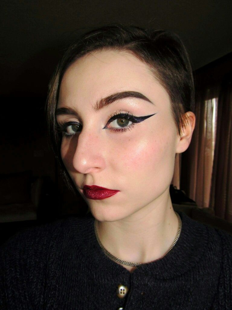 I love wearing a bold, thick liner. A classic red lip with a twist...GLITTER IG : amity.dtd