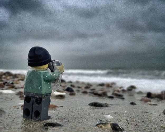 Lego photographer snapping the ocean.