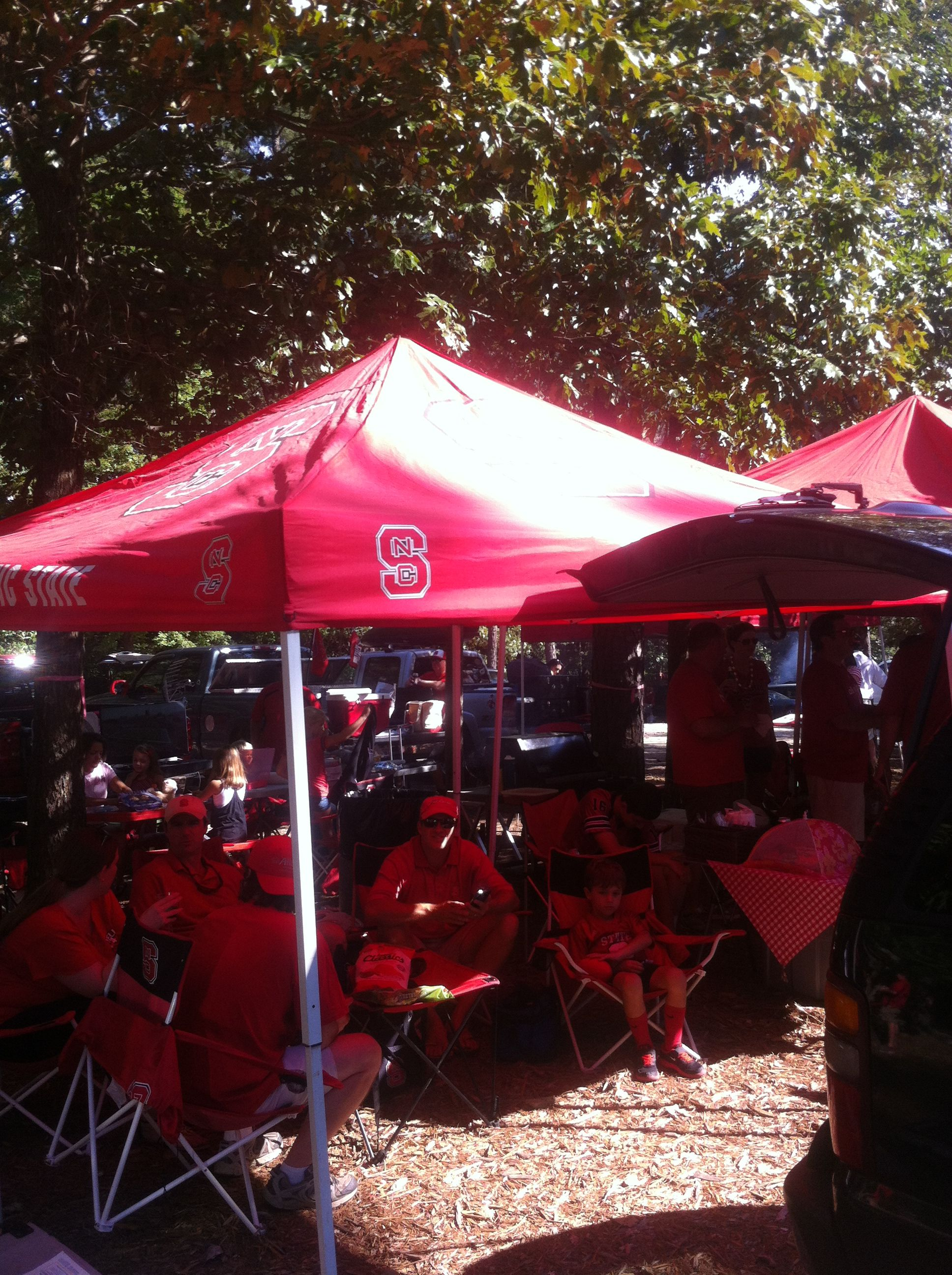 Start off with an NC State Licensed Tent in Red to keep the shade off of & Start off with an NC State Licensed Tent in Red to keep the shade ...