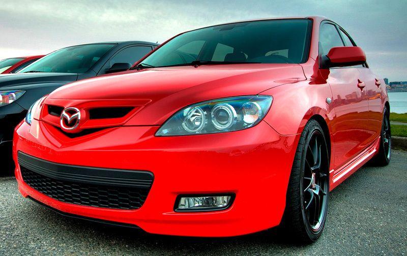 """Red Mazda 3 """"GO UTES"""" 20062011 Mazda"""