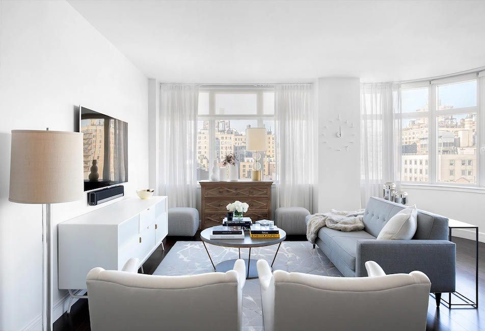 Neutral Light Filled High Rise Apartment Redesign Living Room