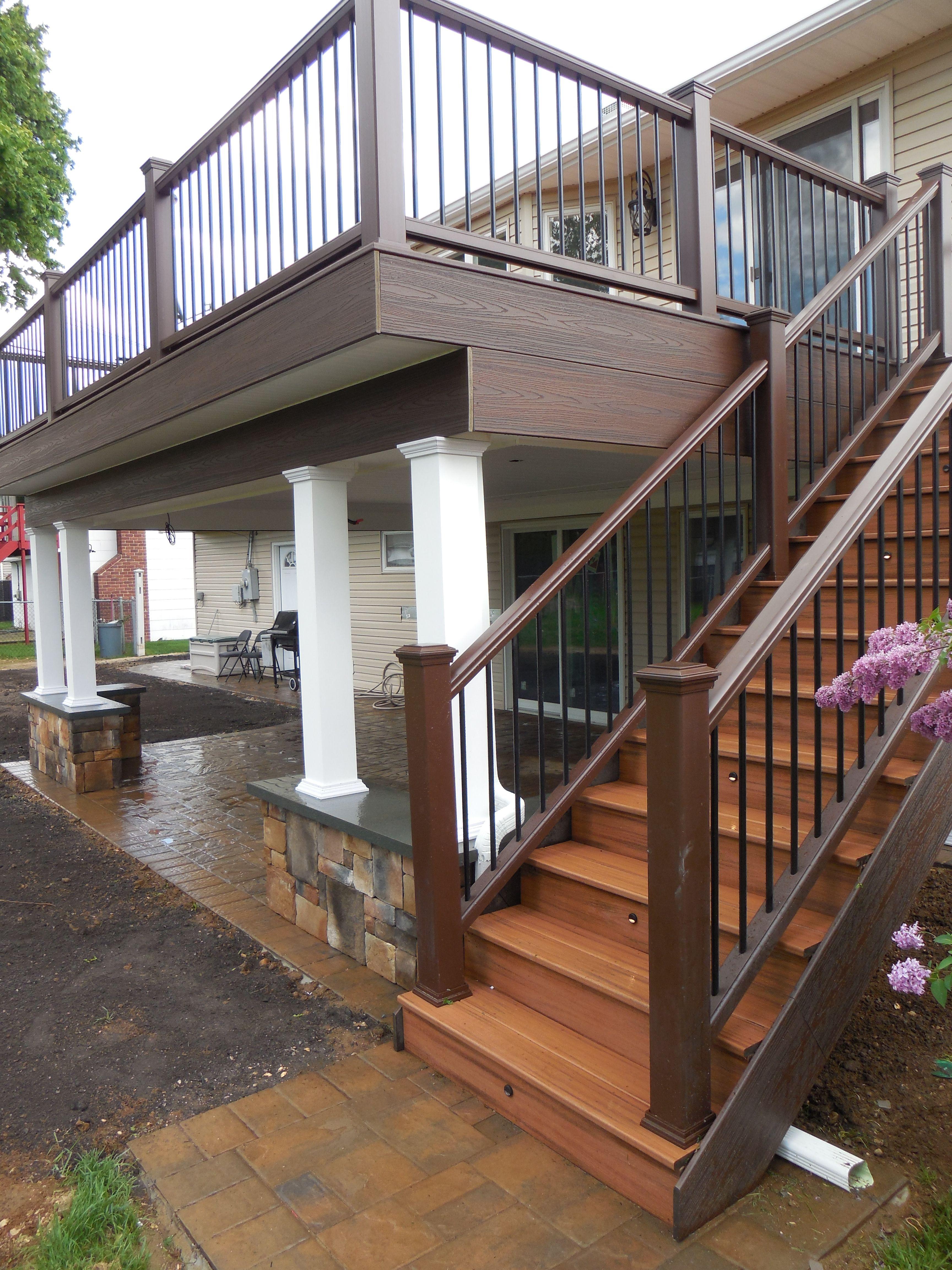 Second Floor Trex Deck With Custom Columns On Stone Walls Patio Deck Designs Porch Design Backyard Patio