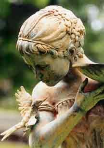 Statue holding a bird bath. Enchanting in any garden..