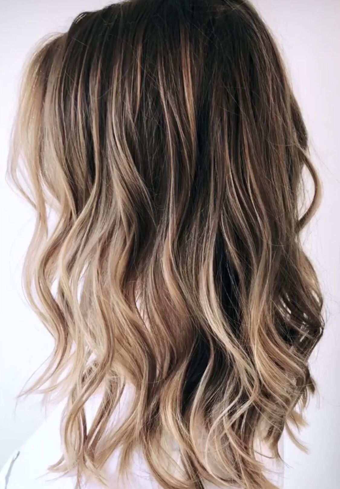 Balayage and beach waves on a medium length haircut for
