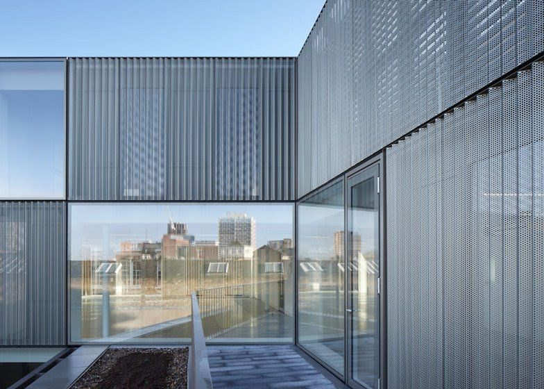 A Rooftop Extension Fronted By Metal Mesh And Glass
